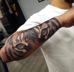 Tattoo Lovers Page Liked · May 23 · Edited · Tiger Tattoo by Martin Mesa — with Md Tonoy, Araujoalonso Guido, Mustak Sama and 15 others at Angry Mom Tattoo Studio.