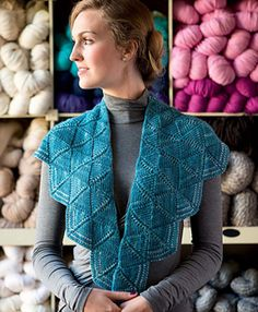 Rows of Twigg stitch fans are stacked one on top of another in nine tiers for this wide, shallow geometric shawl. The first tier begins with a twined-cable cast-on, then three fans are worked in basic Twigg stitch. Each successive tier contains one additional fan, and the fans gradually increase in size to create a gently curved shape. A two-color