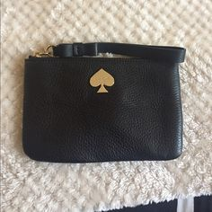 Kate spade wristlet!! Black leather Kate spade wristlet black and white inner lining new without tags kate spade Bags Clutches & Wristlets