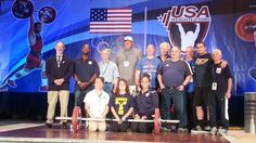 A group photo of some of the Olympians and Olympic Team coaches attending the #WLChampionships2014