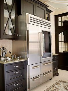 Love the fridge and dark cabinetry in this kitchen.
