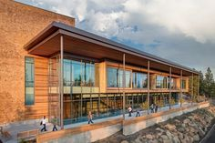 The Central Oregon Community College Science Center in Bend #Oregon features western red #cedar ceiling panels mixed with Douglas-fir paneling and benches and casework to develop warmth in the spaces. #Wood was chosen for its aesthetics ease of construction and #sustainability.  Yost Grube Hall Architecture and Pinnacle Architecture. Photo: Christian Columbres #WoodWorks #StructuralEngineering #Architecture Re-post by Hold With Hope