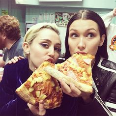 The Celeb Guide to Having a Successful Cheat Day   BRING YOUR FAMOUS FRIEND ALONG   # of calories: 220 per Hawaiian pizza slice  Bella Hadid was smart to bring Miley Cyrus on her pizza run. Turns out the singer is as big of a foodie as the model is, which is the true indicator of a lasting friendship after all.