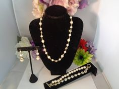 Reduced to $63.00 Vintage Givenchy Goldtone and Faux Pearls with Rhinestones Jewelry Set. The Set includes a 19 inch Necklace an 8 inch Bracelet with a Toggle that says GIVENCHY on the Side and Drop Dangle Faux Pearl Earrings. This is a great Set and the price has been REDUCED. CCCsVintageJewelry.com