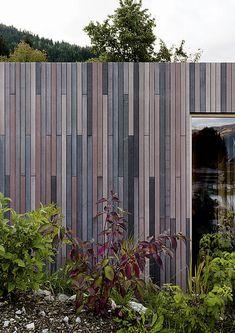 Facade louvers for private spa Maishofen Innovative Architecture, Facade Architecture, Modern Architecture House, Fibre Cement Cladding, Wood Cladding, Wood Facade, Concrete Facade, Timber Buildings, Cladding Materials