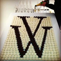 Monogram cupcake display, with champagne.  Fantastic for bridal shower instead of cake