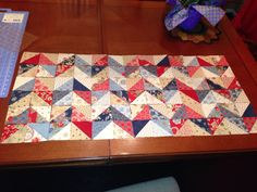 Used Missouri Star Quilt Co uTube tutorial to make chevron table runner using a Charm Square pack.  http://m.youtube.com/watch?v=BUNGH9B0Ohw