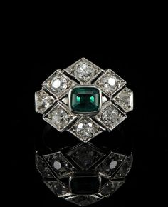 Stunning Art Deco ring, circa 1925. Featuring a central, .85Ct Colombian emerald and 2.20 Ctw old mine cut diamonds.  I love the simple deco design.