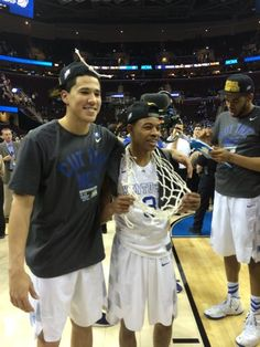 Devin Booker and Tyler Ulis with the net.