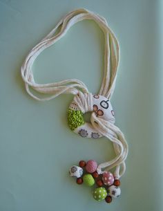 Polymer clay and t-shirt yarn necklace handmade by Manon van Kempen :)
