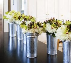 Flowers « David Tutera Wedding Blog • It's a Bride's Life • Real Brides Blogging til I do! Tin pail with flowers.