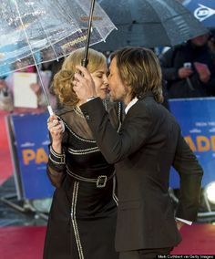 """Nicole Kidman and Keith Urban brought along umbrellas to the rainy London premiere of """"Paddington"""" on Sunday night, but they didn't let the bad weather bring them down. In fact, the husband and wife of eight years shared a kiss on the red carpet, leading even PDA-haters to make an exception, because awwww"""