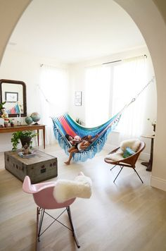Things like hammocks, swings and hanging chairs aren't just for outside: you can also, if you're feeling a bit adventurous, add one to your living room.
