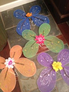 Dollar tree wings embellished with sticks & flowers for fairy garden party favors