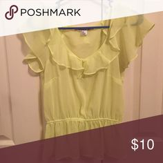Forever 21 Sheer Yellow Ruffle Top Very cute ruffle top from Forever 21. The bright yellow color makes it the perfect summer top! Elastic at waist above the bottom ruffle gives it a sort of peplum look. Gently worn. No stains or holes. Smoke free home. Forever 21 Tops Blouses