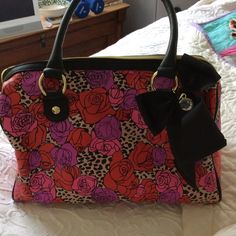 "Betsy Johnson handbag NWOT roses and bow red, pink, and purple bag with black outline and bow and handles. Large. Heavy fabric suitable for rainy day travel or outings. Size 9"" x 14"" x 8-1/2"" wide. New, unmarred. Betsey Johnson Bags"