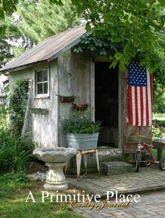 Summer 2012, A Primitive Place & Country Journal magazine. An old coal shed makes an eye-catching focal point in Jan Goos' garden. Photography by Jeremy A. Doss.