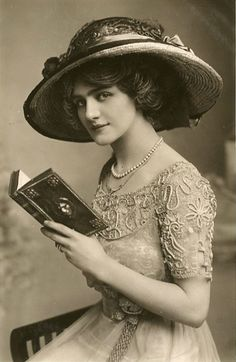 Lily Elsie reading. Elsie (1886–1962) was a popular English actress and singer during the Edwardian era, best known for her starring role in the hit London premiere of Franz Lehár's operetta The Merry Widow.