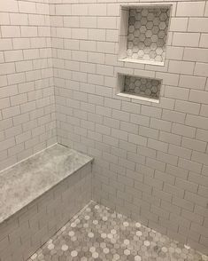 """So after almost 9 years of having to use a super tiny (I'm only 5'0"""" so you know it's small) shower stall, I'm crazy excited about this huge shower with dual shower heads! Shower details- talking mosaics and pencil lines and bands... it had my head spinning! I already confessed that tile was one area in the home I never had a vision for. So I decided to keep it simple: The whitest subway tile to let the pretty marble hex floor and honed marble seat shine. It will be grouted tomorrow with…"""