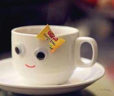 tea cup w/ cut ribbon
