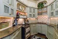 Beacon Hill home has exquisite architectural details, like this charming compact kitchen filled with an old-fashioned-looking yet fully modern Heartland electric stove.  Boston Homes Prime Real Estate Boston MA