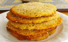 Tortas de aceite de oliva, or olive oil cakes, hail from Seville, Spain. These cookies are super thin, crispy, not too sweet, with anise and sesame seeds in the dough and sprinkled with sugar.
