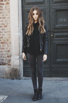 Black ankle boots, leather jacket, and button-up shirt; dark grey skinny jeans