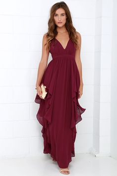 We can't help falling in love with the Water-Falling for You Burgundy Maxi Dress! Lightweight Georgette fabric forms a lightly padded, sleeveless bodice with a plunging neckline and princess seams. Ruffling tiers of fabric cascade from the high waistline to create a show-stopping floor-length maxi that begs to be twirled in. Hidden back zipper/hook clasp at back. Fully lined. Self: 100% Polyester. Lining: 95% Polyester, 5% Spandex. Dry Clean Only.