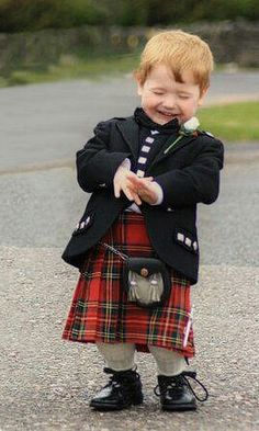 Boy in a kilt HE IS SO CUTE <3 look at him laugh