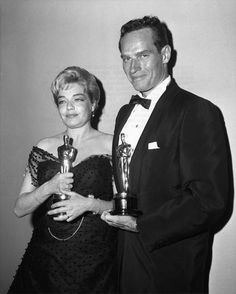 "Best Actress Simone Signoret (""Room at the Top"") and Best Actor Charlton Heston (""Ben-Hur"")."