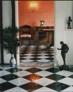 Black and white marble flooring in foyer.