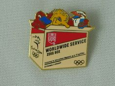 2000 SYDNEY OLYMPIC MASCOTS 25KG BOX PIN BY UNITED PARCEL SERVICE (UPS) MEASURES 1 1/8 INCHES WIDE AND 1 3/16 INCHES HIGH.