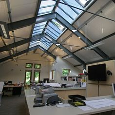 Contemporary design studio by One 17. Steel frame. Roof lights. Open plan.