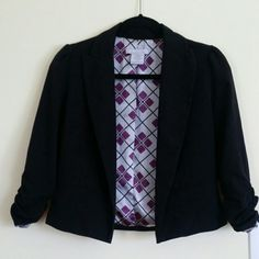 "3/4"" jacket with ruched sleeves Cute open black jacket great to layer with any outfit. Lining has purple patterned detail.  2 faux pockets in the front.   3/4"" sleeves have 4"" ruching that run on both sides.  Shell 66% polyester, 30% rayon, 4% spandex.  Lining 100% polyester.   19"" from collar to bottom of jacket. Charlotte Russe Jackets & Coats"