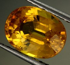 2.38 CTS CERTIFIED YELLOW SAPPHIRE [B34801] Sapphire is one of the two gem varieties of corundum, the other being the red ruby. Although blue is the most well known hue, sapphire is any color of corundum except red. Sapphire may also be colorless, and it also occurs in the non-spectral shades gray and black. Pinkish-orange sapphire is known as padparadscha.