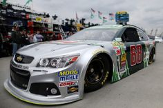 Dale Earnhardt Jr., driver of the #88 Diet Mountain Dew Chevrolet, drives through the garage area during practice for the NASCAR Sprint Cup Series STP 500 at Martinsville Speedway on March 28, 2014 in Martinsville, Virginia. http://www.pinterest.com/jr88rules/nascar-2014/ #NASCAR2014