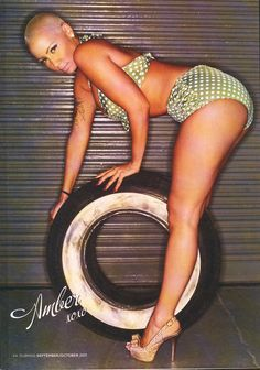 Amber Rose featured in Dub Magazine wearing the Vintage Pinup Bikini in Green Dot by Pinup Couture