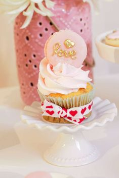 Love is ... a cute cupcake at this Valentine's Day Party!! See more party ideas and share yours at CatchMyParty.com #catchmyparty #cupcake #valentinesday
