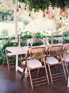 Bamboo chairs white wash table greenery garland copper pendant light installation. Byron loves Fawn.