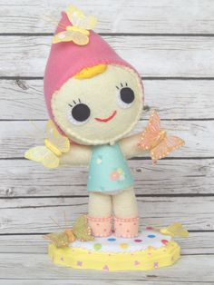 Check out this item in my Etsy shop https://www.etsy.com/listing/269174894/gnome-felt-doll-mariposa-butterfly