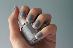 A grey manicure with a sparkled french tip for a modern bride at her wedding.