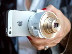 The Sony DSC-QX10/W is a zoom lens and sensor that turns your smartphone into what looks like a conventional camera. Just clip it on to the smartphone in the right place, and you can get shots with the zoom lens that have 10 times the usual reach of a smartphone camera.