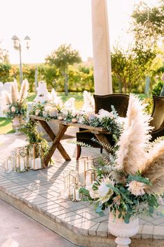 This head wedding table flanked by arrangements of proteas and pampas grass is absolutely breathtaking. | 13 Whimsical Ways to Use Pampas Grass in Your Wedding | #equalitymindedweddings #lgbtweddingmagazine #loveinc #weddingtable #whimsicalwedding #pampasgrasswedding Turquoise Wedding Flowers, Bohemian Flowers, Cheap Wedding Flowers, Floral Wedding, Bohemian Wedding Reception, Whimsical Wedding, Luxe Wedding, Wedding Shit, Wedding Pics