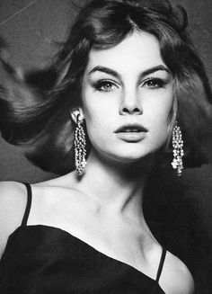 Jean Shrimpton by David Bailey for Vogue, 1962. Straight away in this image you notice the direct eye contact with the camera. The eye line is also quite high and she is looking down on the camera, giving her superiority and power.