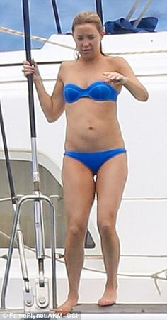 Rearly important:Kate showed off her toned physique in a bright blue two-piece, complete ...
