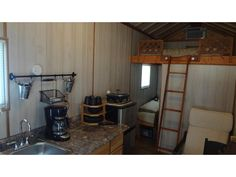 """<b><a href=""""http://tinyhouselistings.com/tiny-cabin-on-wheels-lots-of-extras/"""">The Tiny Cabin On Wheels </a></b> <br>Location: St. Petersburg <br> Price: Contact lister  <br>Size: 145 sq ft  <br> <br>The kitchen comes with a refrigerator, coffee maker, hot plate, microwave toaster oven, electric skillet, some dishes, a 32″ TV and a table with seating for 2."""