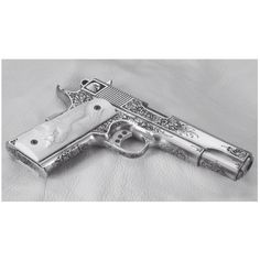 A magnificent Terry Tussey custom 45 auto fabricated from a Caspian Arms frame and slide. When finished, master engraver Eric Gold, who also carved the superb ivory grips, marvelously engraved the gun. This gun is a superb example of the engraver's art.