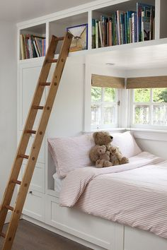 This bed cubby is made exceptional by the small windows and the great amounts of storage provided around the bed's opening.