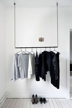 Simple hanging pole with wire to hang clothing                                                                                                                                                                                 More