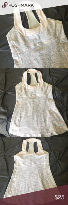 Lululemon Scoop Neck Tank Lululemon scoop neck tank. Reposhing (too small 😣)- just trying to get back what I paid. Pale pink/grey- shelf bra with removable padding. EUC- tiny signs of pilling on neck. lululemon athletica Tops Tank Tops